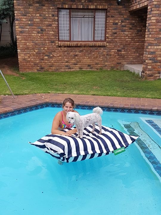 Dog and human enjoying their PoolPillow - Paula Theresa Morley