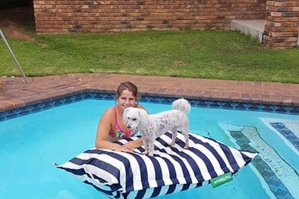 Dog and human enjoying their PoolPillow - Paula Theresa Morley